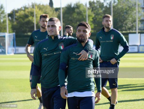 Marco Verratti and Lorenzo Insigne of Italy chat during a Italy training session at Centro Tecnico Federale di Coverciano on October 8, 2019 in...
