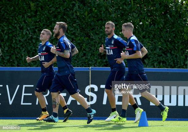 Marco Verratti Daniele De Rossi Leonardo Spinazzola and Andrea Conti of Italy in action during the traning session at Coverciano on August 29 2017 in...