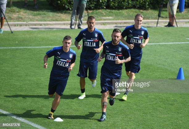 Marco Verratti Leonardo Spinazzola Daniele De Rossi and Andrea Conti of Italy in action during the traning session at Coverciano on August 29 2017 in...