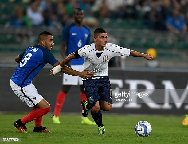 Marco Verratti of Italy and Dimitri Payet of France compete for the ball during the international friendly match between Italy and France at Stadio...