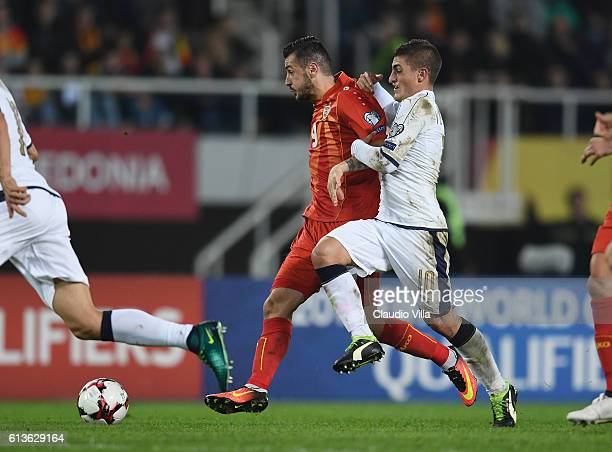 Marco Verratti of Italy and Ilija Nestorovski of FYR Macedonia compete for the ball during the FIFA 2018 World Cup Qualifier between FYR Macedonia...