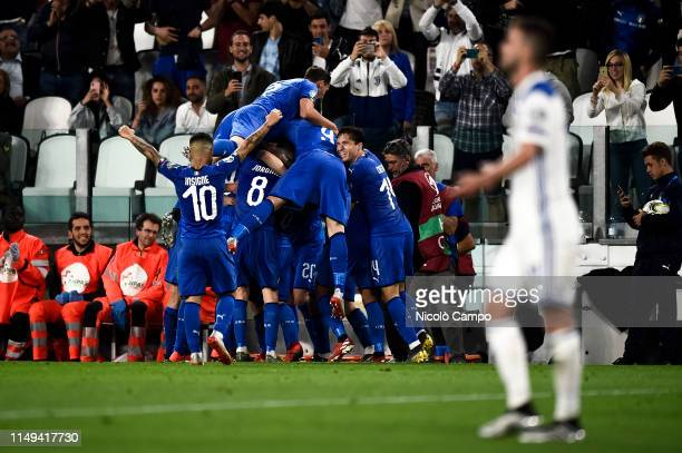 Marco Verratti of Italy celebrates with his teammates after scoring a goal during the UEFA Euro 2020 Qualifier football match between Italy and...