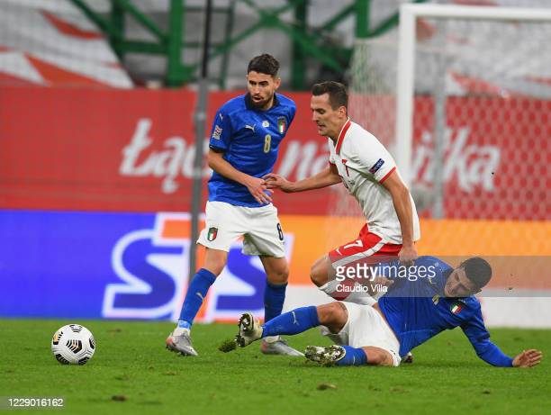 Marco Verratti of Italy competes for the ball with Arkadiusz Milik of Poland during the UEFA Nations League group stage match between Poland and...