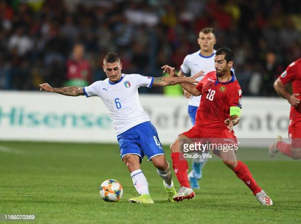 Marco Verratti of Italy competes for the ball with Henrikh Mkhitaryan of Armenia during the UEFA Euro 2020 qualifier between Armenia and Italy at...