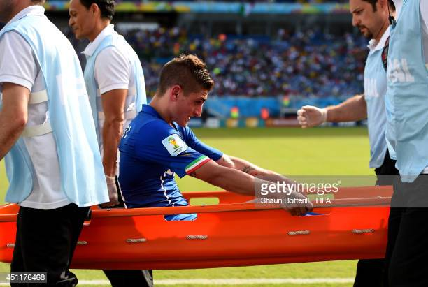 Marco Verratti of Italy is taken off on a stretcher during the 2014 FIFA World Cup Brazil Group D match between Italy and Uruguay at Estadio das...