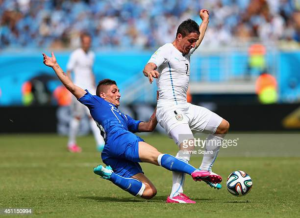 Marco Verratti of Italy tackles Cristian Rodriguez of Uruguay during the 2014 FIFA World Cup Brazil Group D match between Italy and Uruguay at...