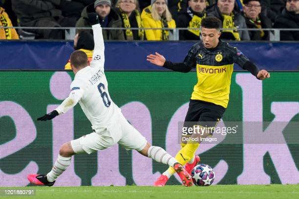 Marco Verratti of Paris SaintGermain and Jadon Sancho of Borussia Dortmund battle for the ball during the UEFA Champions League round of 16 first leg...