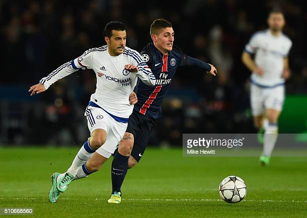Marco Verratti of Paris SaintGermain and Pedro of Chelsea battle for the ball during the UEFA Champions League round of 16 first leg match between...