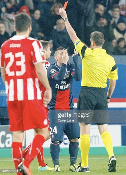 Marco Verratti of Paris SaintGermain receive a red card during the UEFA Champions League between Paris SaintGermain FC and Olympiacos FC at Parc Des...