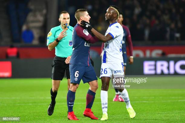 Marco Verratti of PSG and Adama Niane of Troyes clash during the Ligue 1 match between Paris Saint Germain and Troyes Estac at Parc des Princes on...