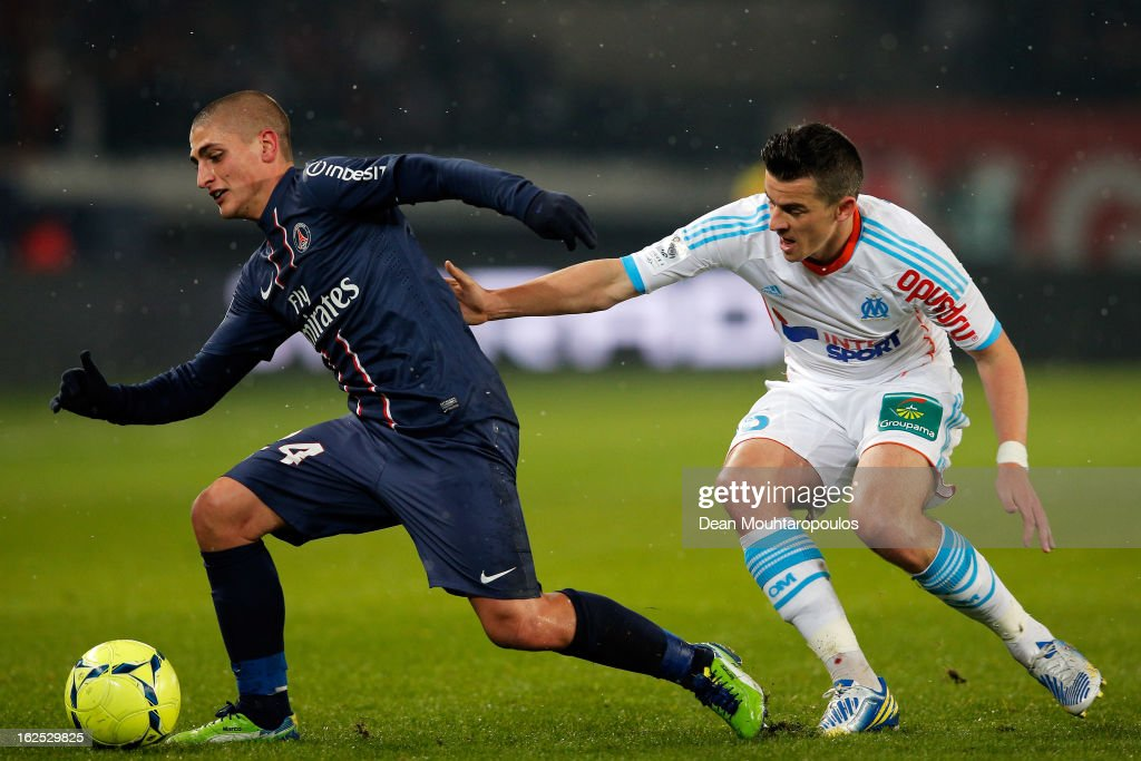 Marco Verratti of PSG and Joey Barton of Marseille battle for the ball during the Ligue 1 match between Paris Saint-Germain FC and Olympique de Marseille at Parc des Princes on February 24, 2013 in Paris, France.