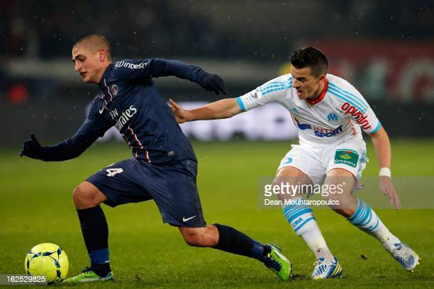 Marco Verratti of PSG and Joey Barton of Marseille battle for the ball during the Ligue 1 match between Paris SaintGermain FC and Olympique de...
