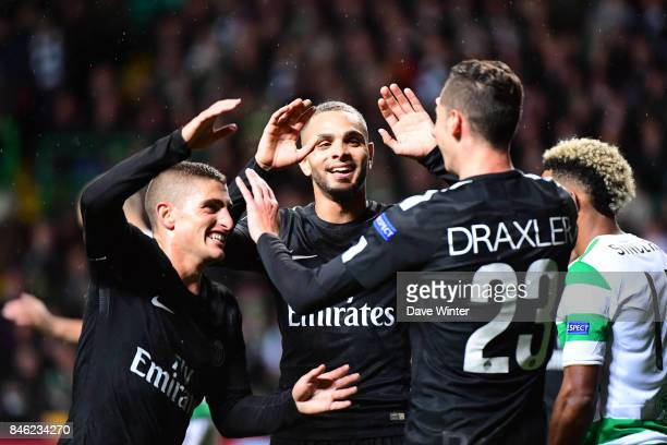 Marco Verratti of PSG and Layvin Kurzawa of PSG congratulate Julian Draxler of PSG after his cross leads to an own goal by a Celtic player during the...