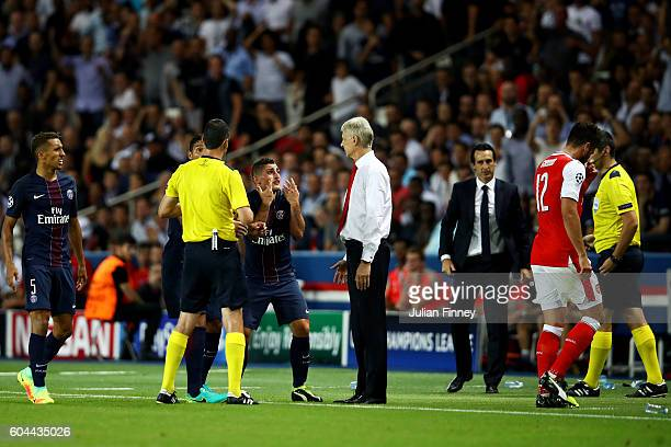 Marco Verratti of PSG and Olivier Giroud of Arsenal are both shown a red card during the UEFA Champions League Group A match between Paris...