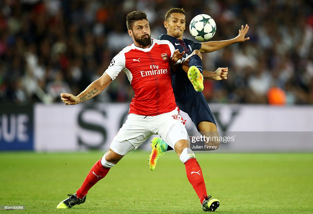 Marco Verratti of PSG and Olivier Giroud of Arsenal in action during the UEFA Champions League Group A match between Paris Saint-Germain and Arsenal FC at Parc des Princes on September 13, 2016 in Paris, France.