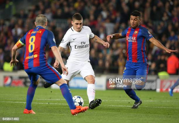 Marco Verratti of PSG and Rafinha of FC Barcelona in action during the UEFA Champions League Round of 16 second leg match between FC Barcelona and...