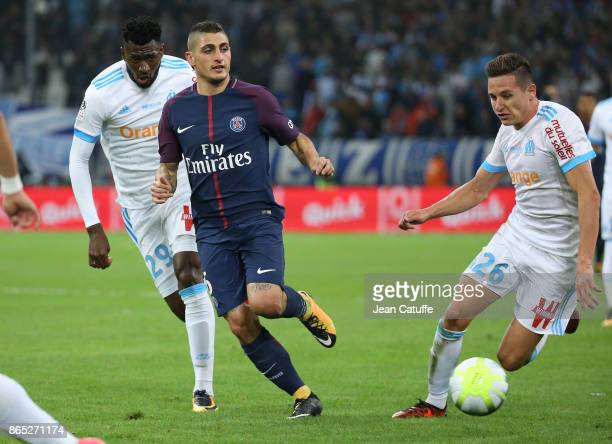 Marco Verratti of PSG between Andre Zambo Anguissa and Florian Thauvin of OM during the French Ligue 1 match between Olympique de Marseille and Paris...