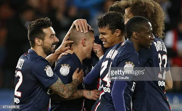Marco Verratti of PSG celebrates his goal with Thiago Silva pinching his nose Ezequiel Lavezzi Blaise Matuidi of PSG during the French Ligue 1 match...