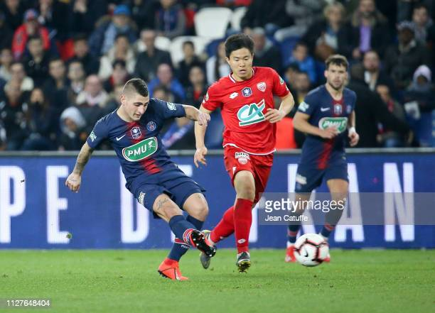 Marco Verratti of PSG, Chang-hun Kwon of Dijon during the French Cup quarter-final match between Paris Saint-Germain and Dijon Football Cote-d'Or at...