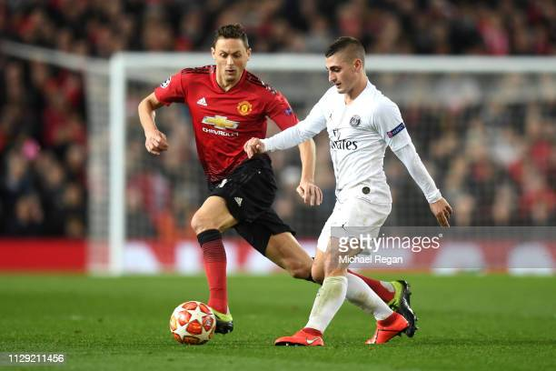 Marco Verratti of PSG is closed down by Nemanja Matic of Manchester United during the UEFA Champions League Round of 16 First Leg match between...
