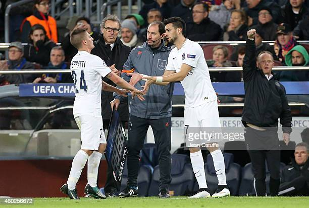 Marco Verratti of PSG is replaced by Javier Pastore of PSG while head coach of PSG Laurent Blanc looks on during the UEFA Champions League Group F...