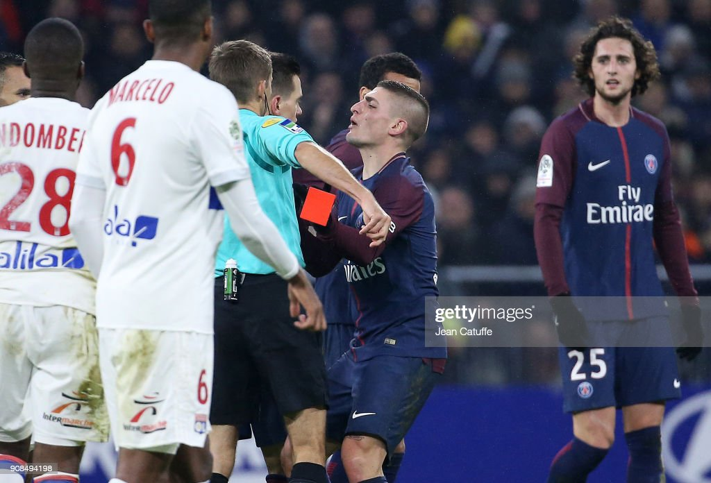 Marco Verratti of PSG kicks inadvertently the red card aimed at Dani Alves of PSG from the hand of referee Clement Turpin during the French Ligue 1 match between Olympique Lyonnais (OL) and Paris Saint Germain (PSG) at Groupama Stadium on January 21, 2018 in Lyon, France.