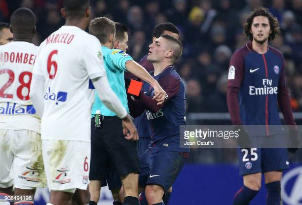 Marco Verratti of PSG kicks inadvertently the red card aimed at Dani Alves of PSG from the hand of referee Clement Turpin during the French Ligue 1...
