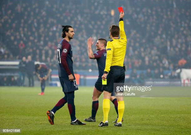 Marco Verratti of PSG receives a red card and is sent off by referee Felix Brych of Germany while Javier Pastore of PSG looks on during the UEFA...