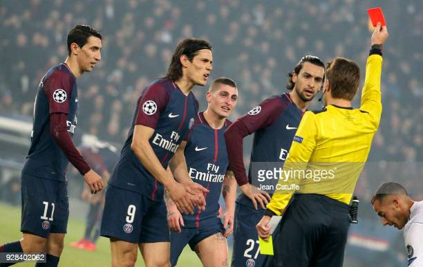 Marco Verratti of PSG receives a red card and is sent off by referee Felix Brych of Germany while Angel Di Maria Edinson Cavani and Javier Pastore...