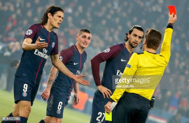 Marco Verratti of PSG receives a red card and is sent off by referee Felix Brych of Germany while Edinson Cavani and Javier Pastore protest during...