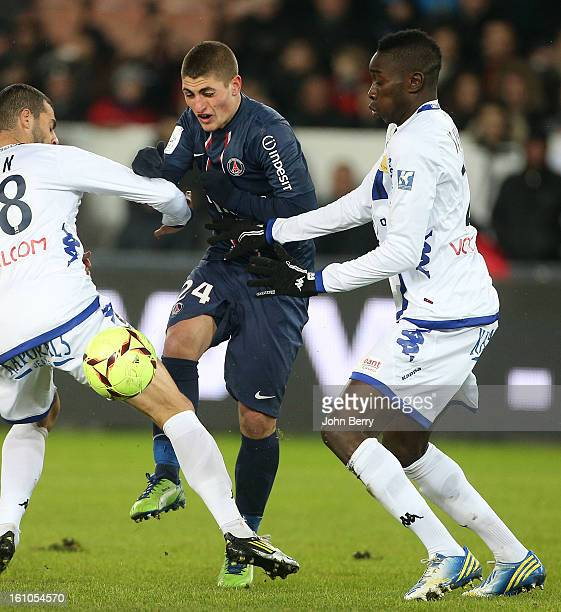 Marco Verratti of PSG sandwiched by Ilan Araujo Dall'Igna and Sambou Yatabare of SC Bastia during the French Ligue 1 match between Paris Saint...