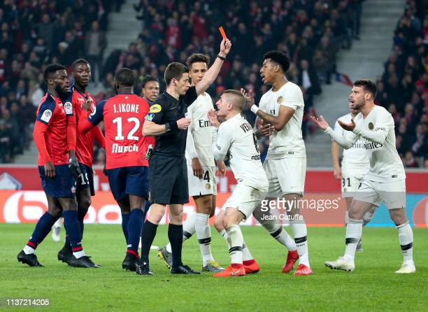Marco Verratti Presnel Kimpembe of PSG protest against the red card delivered by referee Benoit Bastien to Juan Bernat of PSG during the French Ligue...