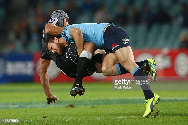 Marco Wentzel of the Sharks is tackled by Rob Horne of the Waratahs during the round 14 Super Rugby match between the Waratahs and the Sharks at...