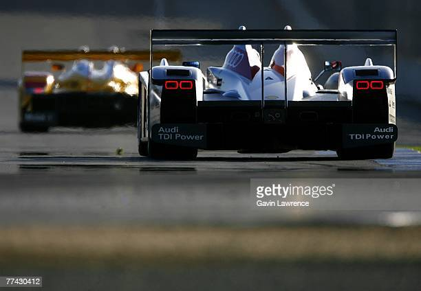 Marco Werner of Germany driving the Audi Sport North America Audi AG R10/TDI chases Ryan Briscoe of Australia in the Penske Racing Porsche RS Spyder...