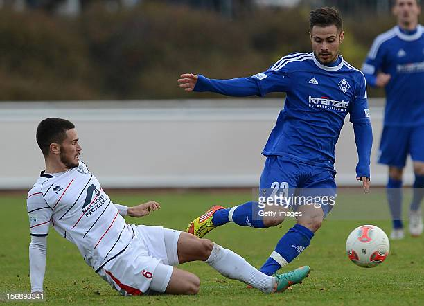 Marco Wiedmann of Seligenporten challenges Florian Peruzzi of Illertissen during the Regionalliga Bayern match between FV Illertissen and SV...