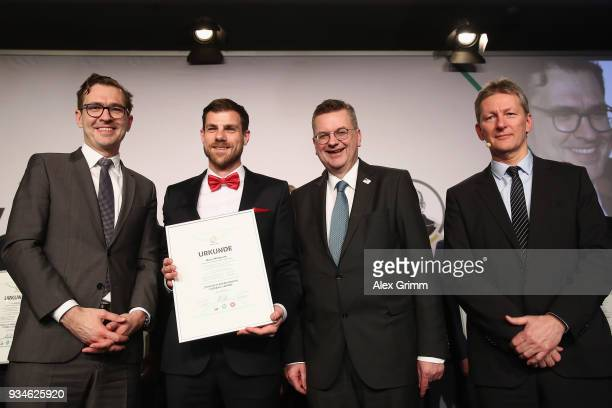 Marco Wildersinn poses with DFB Secretary General Friedrich Curtius DFB President Reinhard Grindel and Frank Wormuth after receiving his certificate...