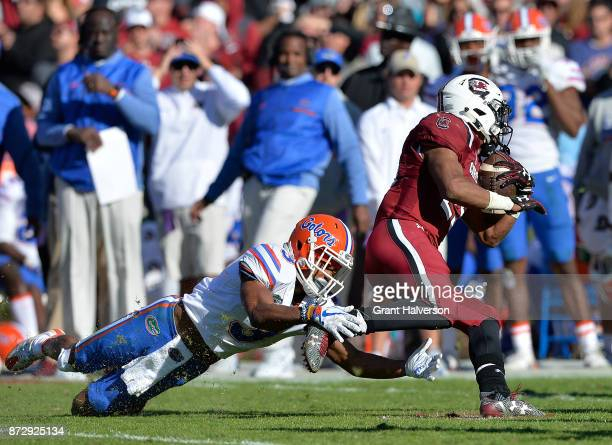 Marco Wilson of the Florida Gators dives to tackle AJ Turner of the South Carolina Gamecocks during their game at WilliamsBrice Stadium on November...