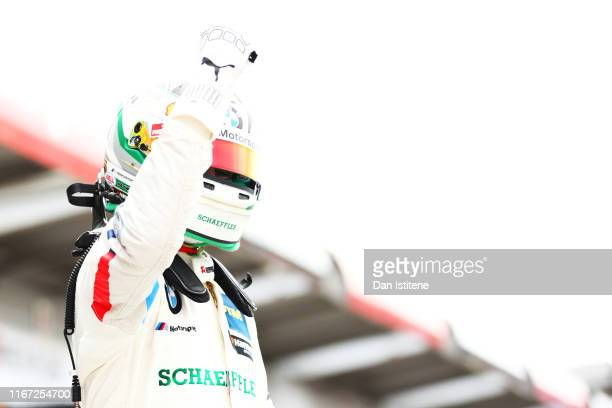 Marco Wittmann of Germany and BMW Team celebrates victory in parc ferme after the DTM Race 1 at Brands Hatch on August 10 2019 in Longfield England