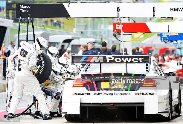 Marco Wittmann of Germany and BMW Team MTEK makes a pit stop during the training session for the third round of the DTM 2013 German Touring Car...