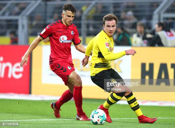 MarcOliver Kempf of Freiburg and Mario Goetze of Dortmund battle for the ball during the Bundesliga match between Borussia Dortmund and SportClub...