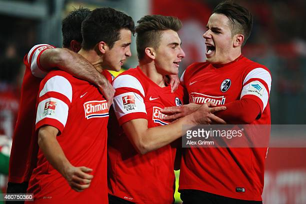 MarcOliver Kempf of Freiburg celebrates his team's second goal with team mates Maximilian Philipp and Christian Guenter during the Bundesliga match...
