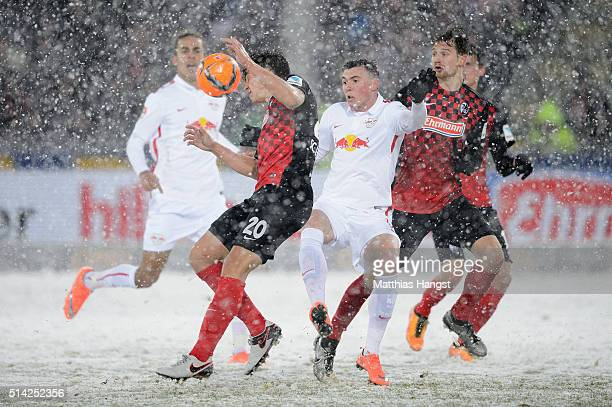 MarcOliver Kempf of Freiburg is challenged by Nils Quaschner of RB Leipzig during the Second Bundesliga match between SC Freiburg and RB Leipzig at...