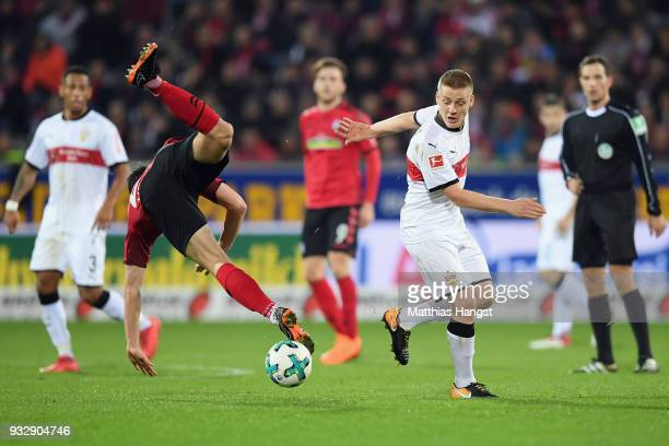 MarcOliver Kempf of Freiburg is challenged by Santiago Ascacibar of Stuttgart during the Bundesliga match between SportClub Freiburg and VfB...
