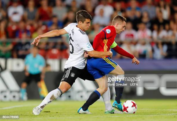 MarcOliver Kempf of Germany and Gerard Deulofeu of Spain battle for possession during the UEFA European Under21 Championship Final between Germany...