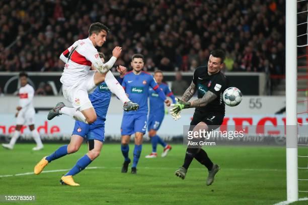 MarcOliver Kempf of Stuttgart scores his team's first goal past goalkeeper Kevin Mueller of Heidenheim during the Second Bundesliga match between VfB...