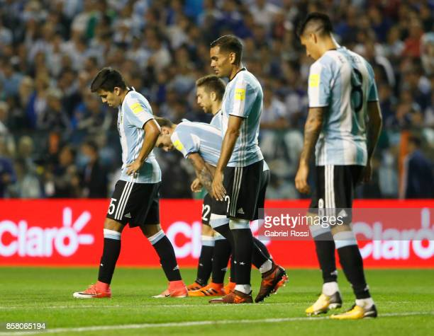 Marcos Acuña Gabriel Mercado and Enzo Perez of Argentina look dejected after a match between Argentina and Peru as part of FIFA 2018 World Cup...