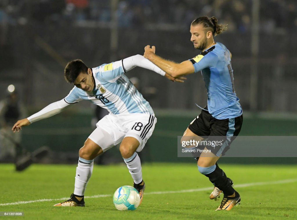 Marcos Acuña of Argentina and Gaston Silva of Uruguay fight for the ball during a match between Uruguay and Argentina as part of FIFA 2018 World Cup Qualifiers at Centenario Stadium on August 31, 2017 in Montevideo, Uruguay.