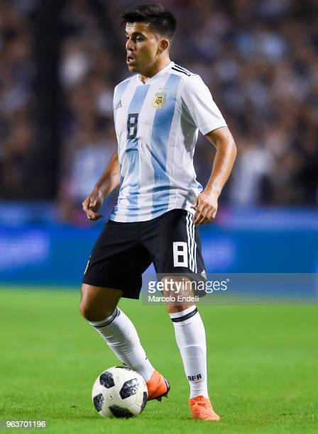 Marcos Acuña of Argentina drives the ball during an international friendly match between Argentina and Haiti at Alberto J Armando Stadium on May 29...