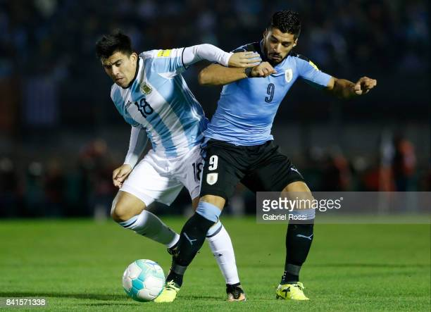 Marcos Acuña of Argentina fights for the ball with Luis Suarez of Uruguay during a match between Uruguay and Argentina as part of FIFA 2018 World Cup...