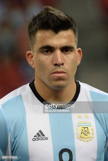 Marcos Acuña of Argentina poses before the start of their international friendly football match against Singapore at the National Stadium in...